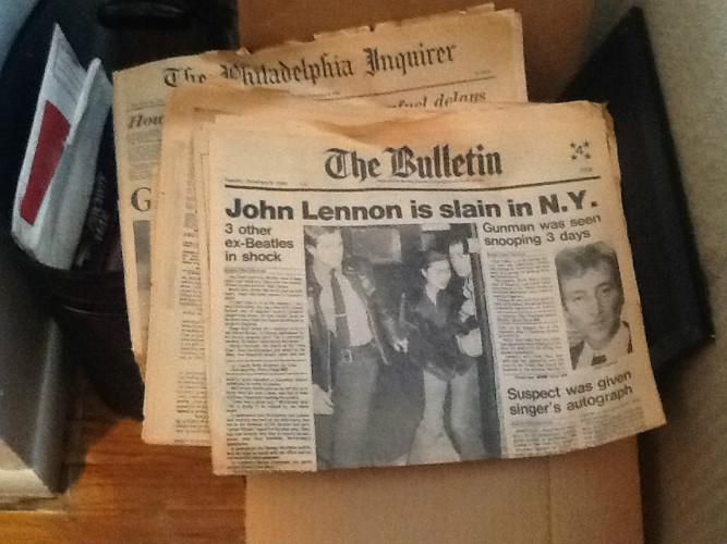 Newspaper headline: John Lennon is Slain