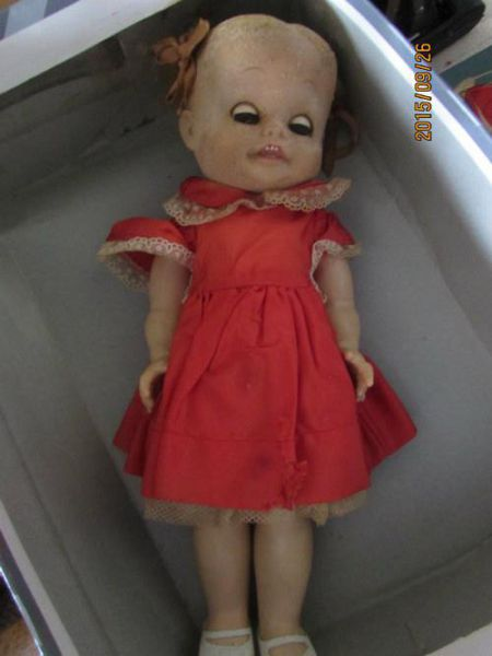Creepy Doll in Red Dress
