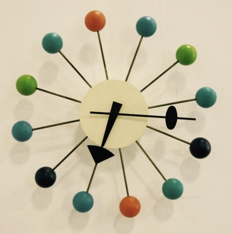 1. The mod style of this wall clock became popular during the mid century: