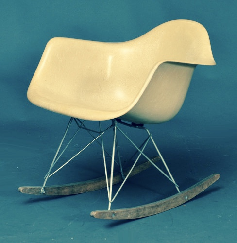 This iconic chair (shown on rockers here) has a simple, easily fabricated design, thanks to its shell made from what kind of synthetic material?