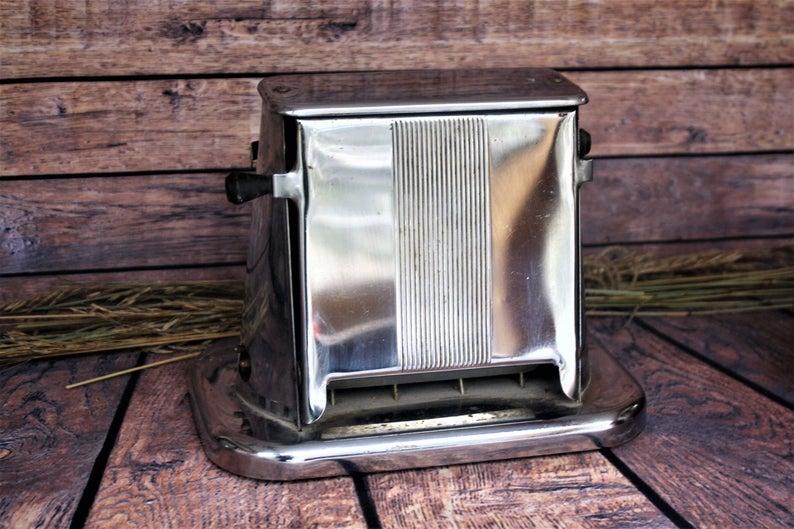 Chrome toaster on wood.