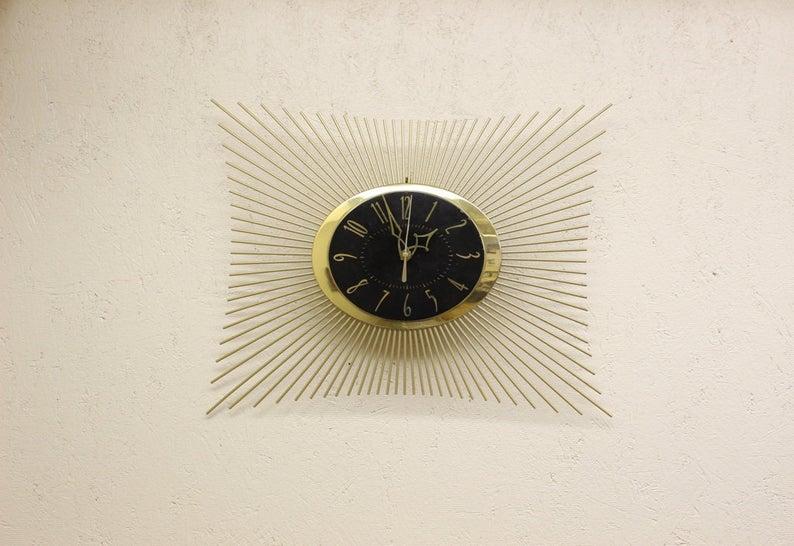black and gold starburst wall clock