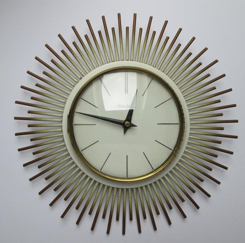 A 1960s Henlein sunburst wall clock.