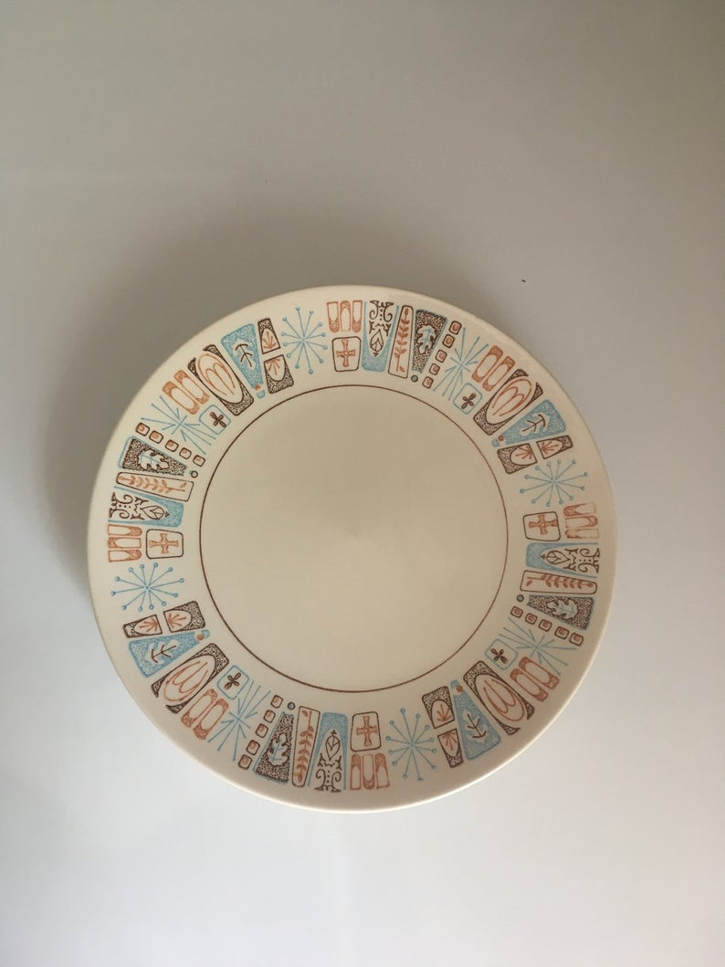 Ceramic plate with blue and brown border