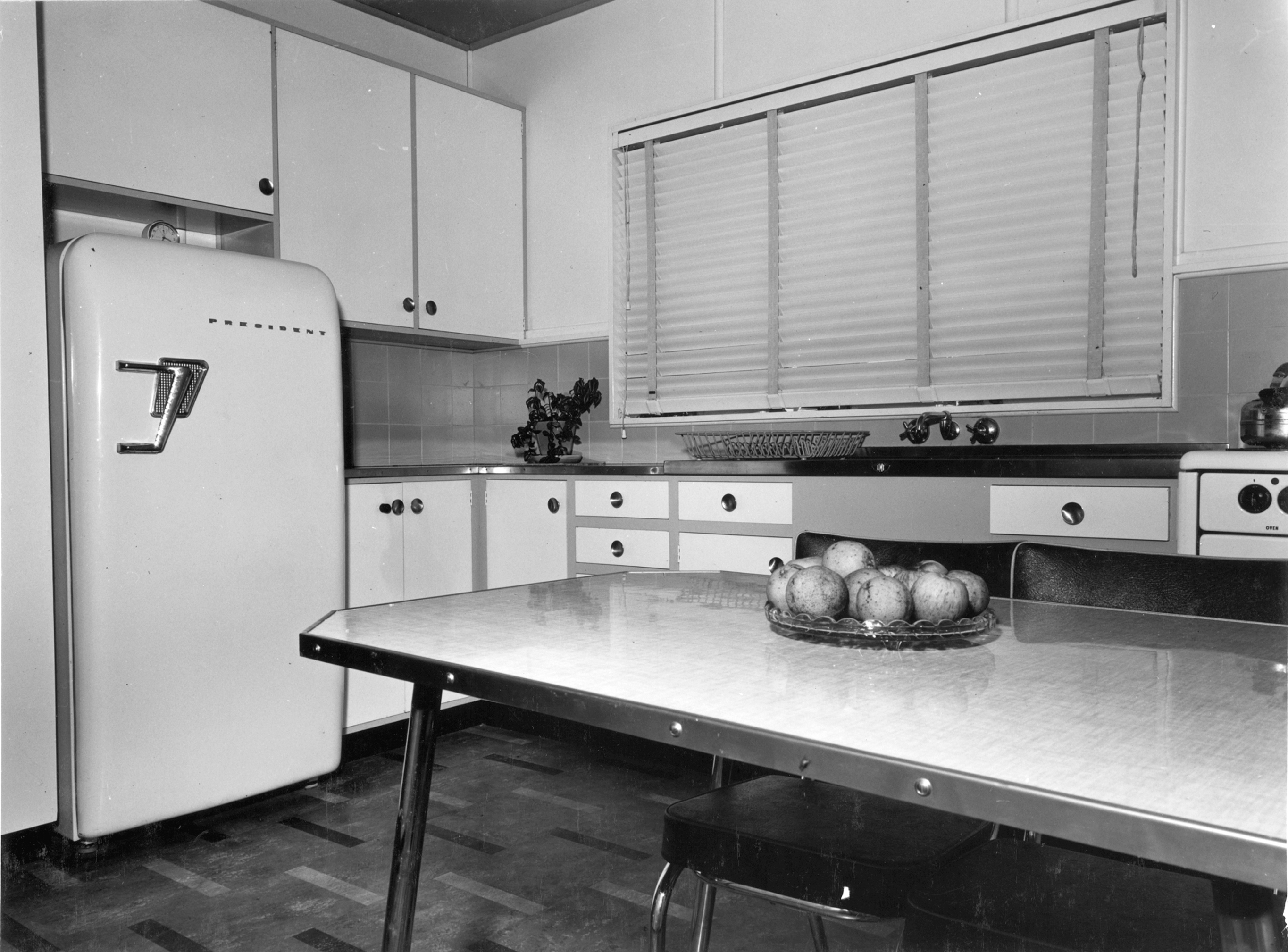 black and white image of old kitchen