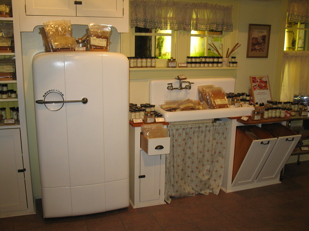 Retro kitchen with white fridge and small sink.