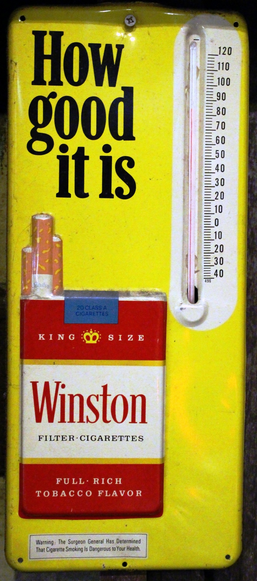Metal sign advertising Winston cigarettes with a thermometer attached.