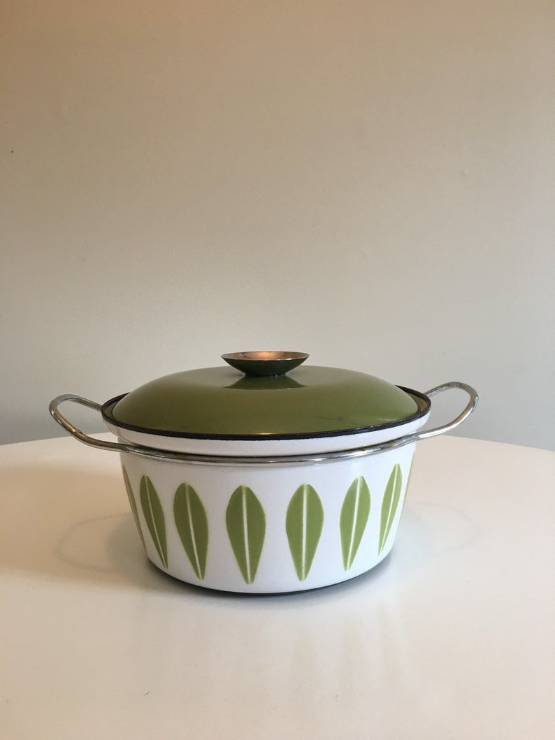 White and green enamel pot with green lid.