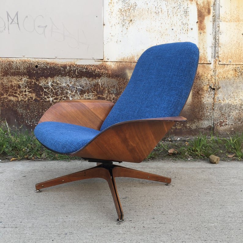 Wooden chair with blue upholstery.
