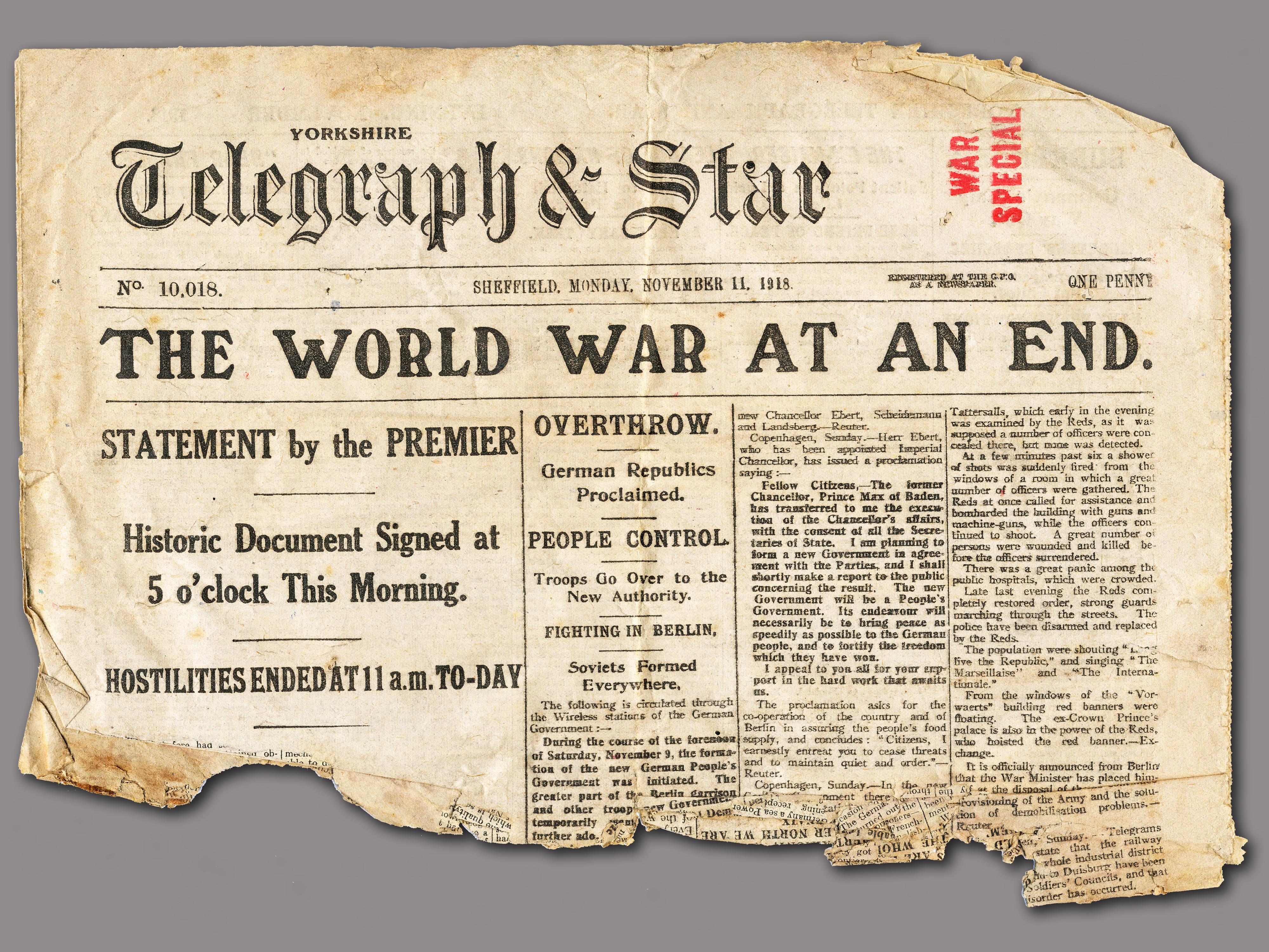 """Newspaper headline reads """"The World War At An End."""""""