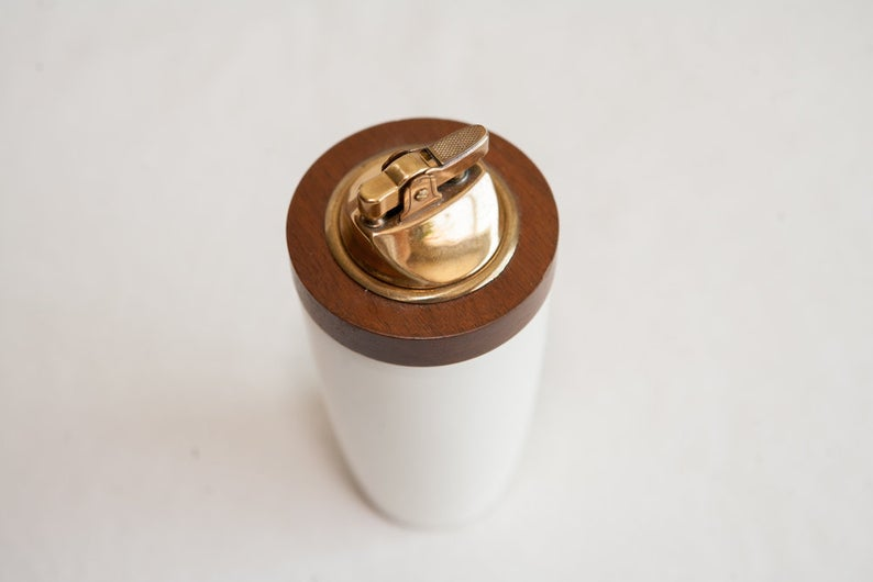 White, wooden and gold lighter.
