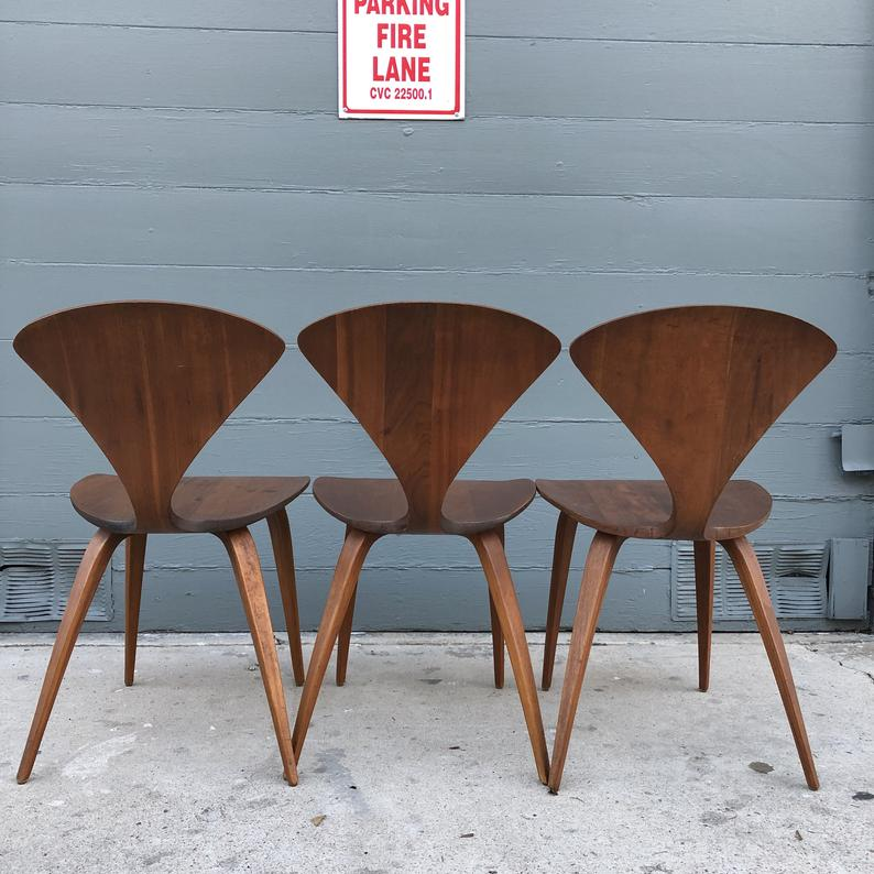 Three brown wooden chairs