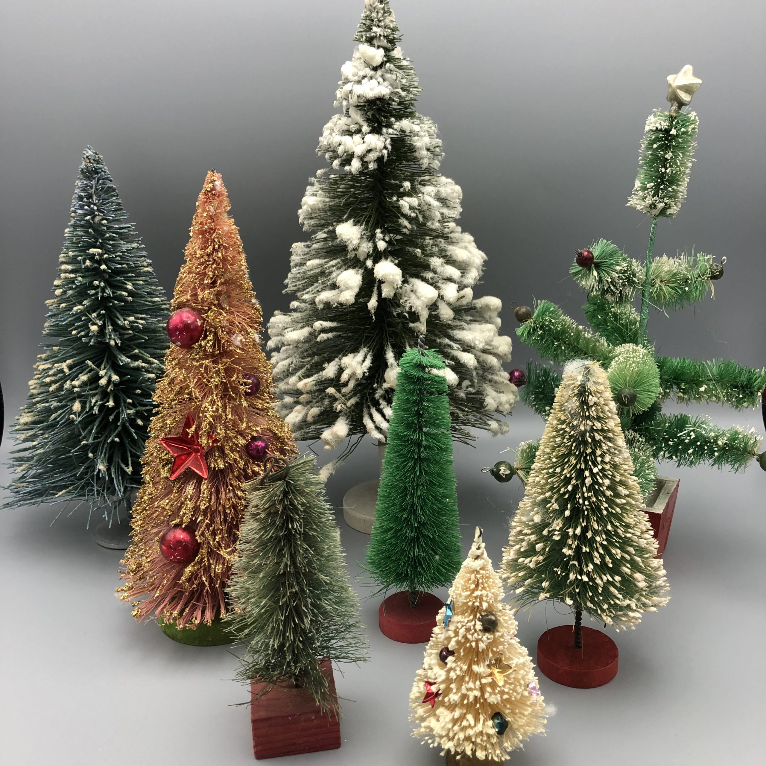 Set of 2 wooden handpainted Santa Clauses on wooden skis wearing red knitted toboggans Christmas trees ornaments /& other kitschy displays.