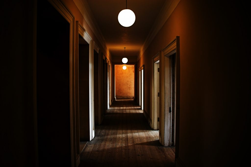 poorly lit estate hallway