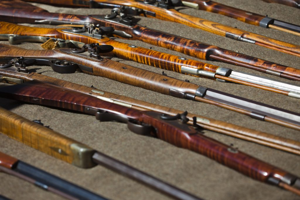guns on display at an estate sale